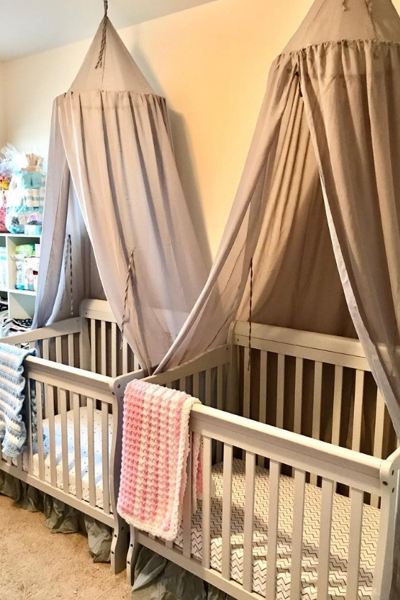 twin nursery with canopies