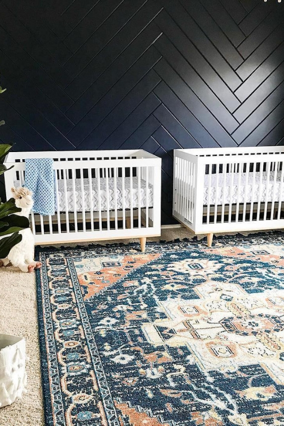 twin nursery with a beautiful blue accent wall
