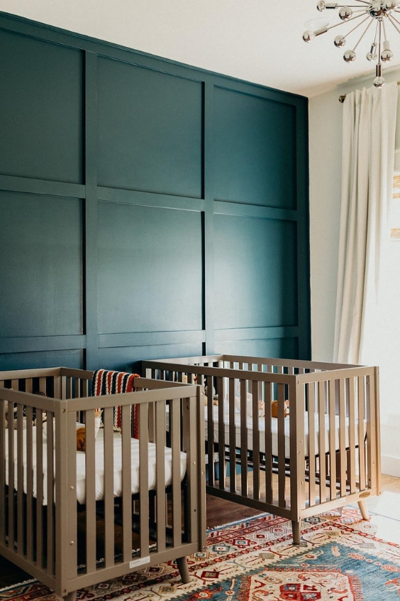 twin nursery with beautiful green accent wall