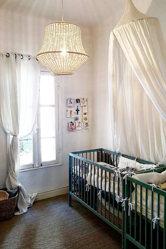 twin nursery with green cribs