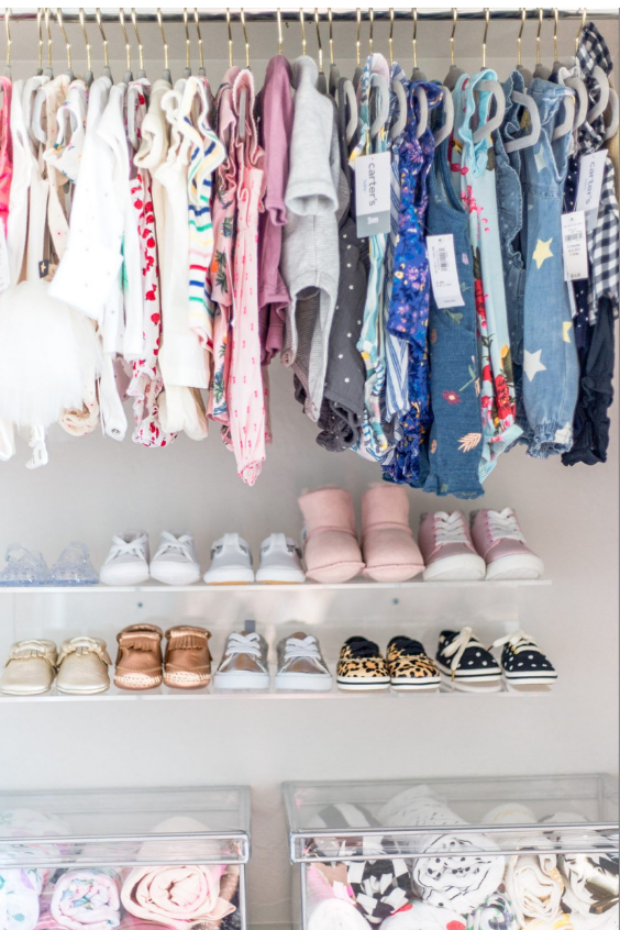 organizing baby's shoes in the nursery